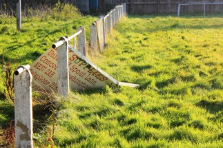 A forgotten advertising hoarding behind one of the goals at Albany Park.