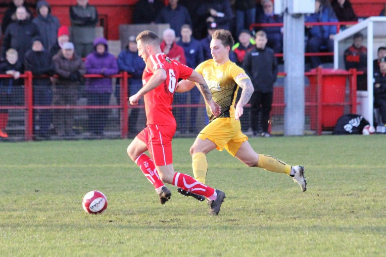 Action as Workington (Red) take on Basford Utd in the Evo-Stik Premier League.