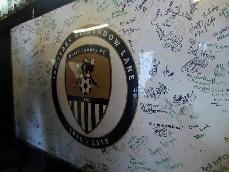 A mural celebrating 100 years of football at Meadow Lane.