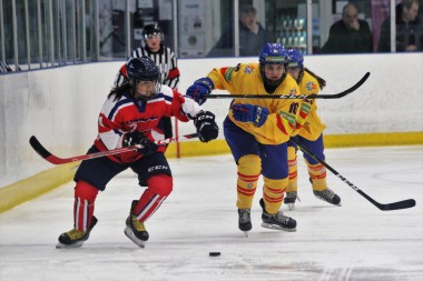 Action as North Korea (red) takes on Spain in Women's World Championship Division IIA in Dumfries.