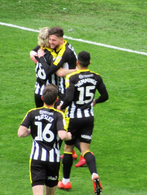 Notts County celebrate their first goal against Grimsby Town.