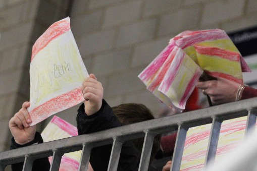 Schoolchildren in Dumfries wave home-made Spanish flags during a game between Spain and North Korea at the IIHF WWIIA.
