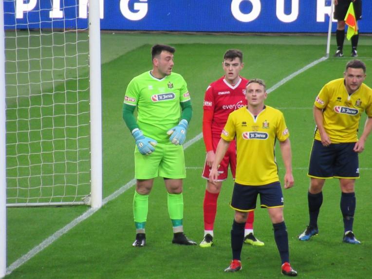 Marske Utd (yellow) prepare to defend a Scarborough corner.