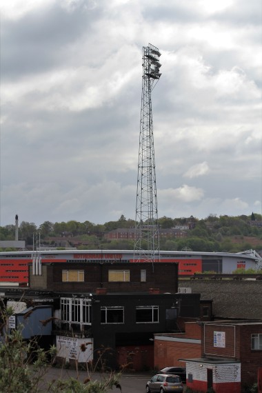 An old Millmoor floodlight and the New York Stadium in the background.
