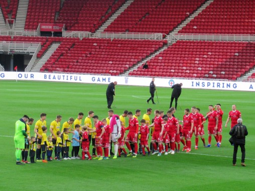 The teams observe the formalities before kick-off.
