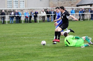 Action as Coldstream (blue) take on Musselburgh in the East of Scotland League.