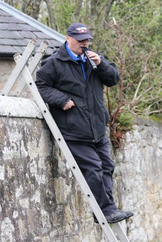 An unorthodox commentary position against the old school wall at Coldstream's Home Park ground.