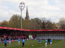 Distinctive new floodlights and an old church spire at Salford City.