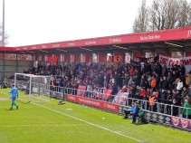The home terrace fills up at Salford City.