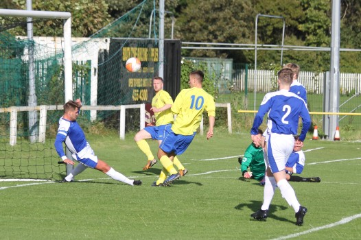 Action as the Wearside League (yellow) takes on the West Cheshire League in the FA Inter-League Cup.