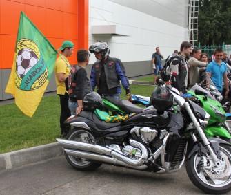 A biker flies the flag outside the Kuban Stadium, Krasnodar.
