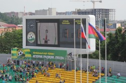 The scoreboard at the Kuban Stadium, Krasnodar. Below the screen, the slogan reads 'History. Tradition. Victories.'