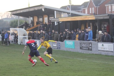 Action as West Auckland (yellow) take on Yorkshire Amateur in the FA Vase.