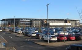 Stadium MK as viewed across the retail park carpark.